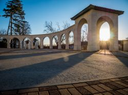 photo of arches on campus with morning light showing through