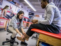 Photo of athletic training students assisting athletes.