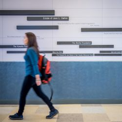 A student moves through the CELS building lobby