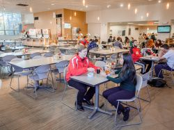 photo of Photo of Red Hawk for a Day Host and student in Freeman Dining Hall