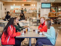 photo of Hosts and Students inside Freeman Dining Hall