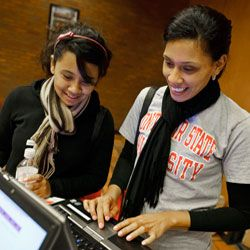 Alumni using computer to sign up for benefits