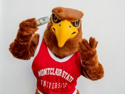Rocky the Red Hawk holding up a twenty dollar bill.