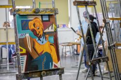 Vaguely Cubist student painting resting on easel in studio