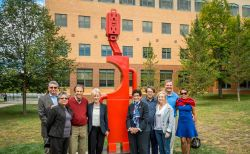 "At the dedication of Carol Brown Goldberg's ""Secret Totem."" From left to right: Gary Siegel (New Arts Foundry), Teresa Rodriguez (Director, George Segal Gallery), Hank Goldberg, Carol Brown Goldberg, Susan Cole (President, Montclair State University), Bennett Goldberg, Danielle McDonald, Chas Colburn (Chas Colburn Sculpture Studio), and Prima Colburn."