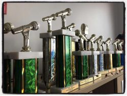 A row of trophies on a shelf for wmsc radio awards