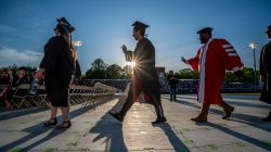 Graduates-casting-long-shadows-walking-for-convocation