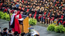 Undergraduate Commencement speaker addresses crowd from podium