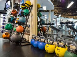 Kettle bells stacked next to a mirror
