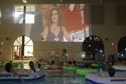 Students participating in the Dive-In Movie night in the Campus Recreation Center Pool!