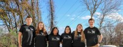 The six Recboard E-board members standing outside with matching black recboard t-shirts.