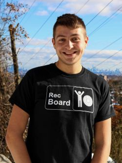 Nick Parente in a black recboard shirt standing outside.