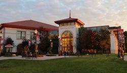 The student recreation center in the morning time and autumn trees in front of the building