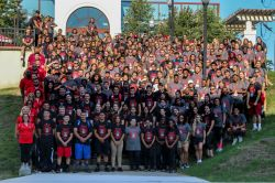 Group picture of all the campus rec center employees outside the rec center
