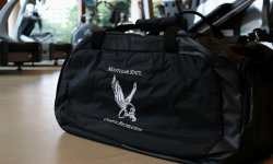 black montlcair state campus recreation duffle bag with the red hawk logo in white