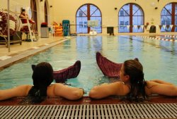 2 students in mermaid tails