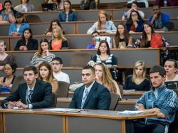 Students attending a session in their business attire.