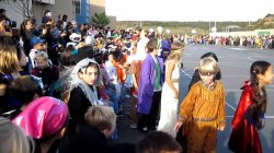 Photo of children in halloween costumes in school parade.