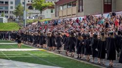 Photo of CEHS graduates entering the field for convocation.