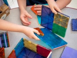 Photo of children playing with magnatiles.