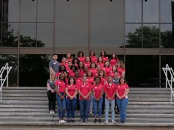 The Orientation Leaders posing for a photo on the front steps of the Student Center