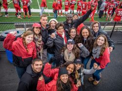 group of students with Dr. Cole at homecoming