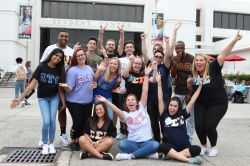 group of greek students in front of the student center