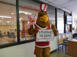 rocky holding up a sign saying he will pledge to vote