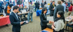 employers and students speaking at career fair