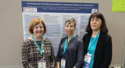Mary Boyle, Christa Akers, and Roberta Elman with their poster at the recent ASHA convention in Boston.