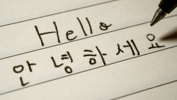 "handwriting on paper of word ""Hello"" in English and Korean"