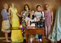 Photo of actresses in spanish language play of Real Women Have Curves. Pictured with dresses and sewing equipment