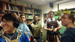 students in classical garb in professor's office