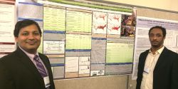 mentor and student with research poster