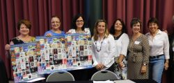 Members of the ITANJ Executive Committee with IHCC annual poster