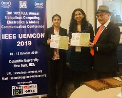 receiving best paper award certificates at UEMCON 2019