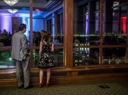 Two guests taking in the magnificent views of New York City from the Conference Center Ballroom.