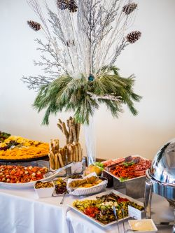 A variety of food displayed prominently on a table at the Conference Center in the Main Ballroom.