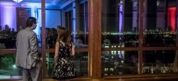 Two guests admiring the view from the Main Ballroom in the Conference Center.
