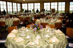 2006 Annual Dinner in the University Hall conference center. Some tables set up with place-cards and settings.