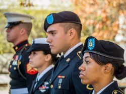 Image of military students at Veteran's Day flag raising event on Montclair State University campus.