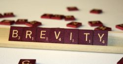 """brevity"" spelled out in Scrabble tiles"