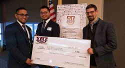 Sirawar Matin, left, and Iffat Siddiqi, center, celebrate their UPitchNJ prize with Prof. Jason Frasca.