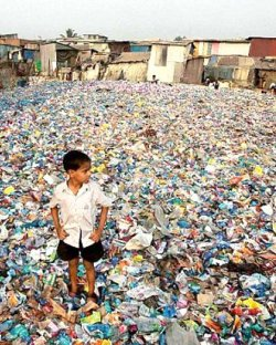Child standing on a plastic heap