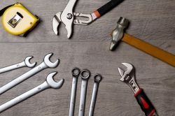 collection of tools: wrenches, hammer, sockets