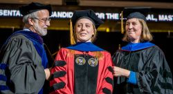 Dr. Melissa Hansen (center) is hooded by her advisor, Earth and Environmental Studies professor Dr. Sandra Passchier (right) and CSAM Dean Dr. Robert Prezant (left)