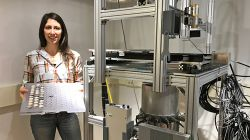 Christina Verhagen next to lab equipment