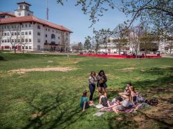 Students sitting in the Student Center Quad.
