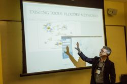 Image of a faculty member presenting about Digital Humanities.