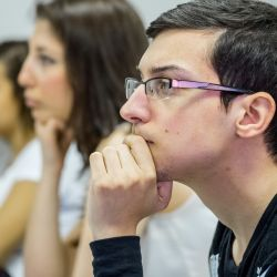Image of a student listening in class.